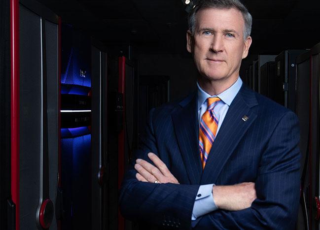 Steve Powless standing by mainframe